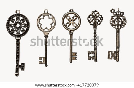 A set of five decorative keys. Isolated on white. - stock photo