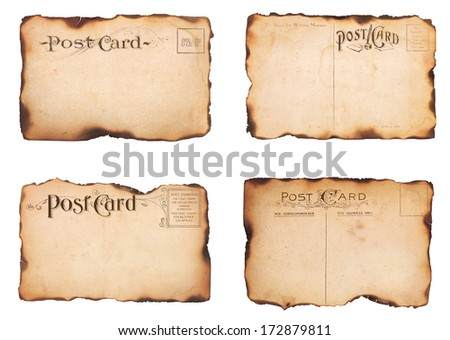 A set of four heavily aged, unstamped post cards from early 1900s.  Postcards are mostly empty with room for additional text and images. Isolated on white. - stock photo