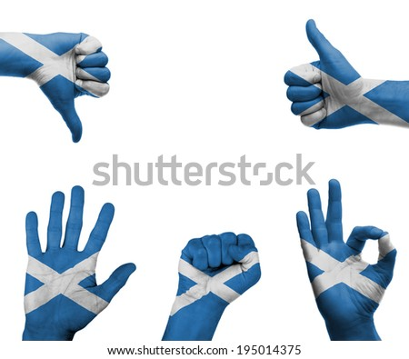 A set of hands with different gestures wrapped in the flag of Scotland - stock photo