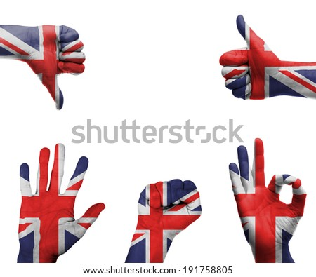 A set of hands with different gestures wrapped in the flag of the UK - stock photo