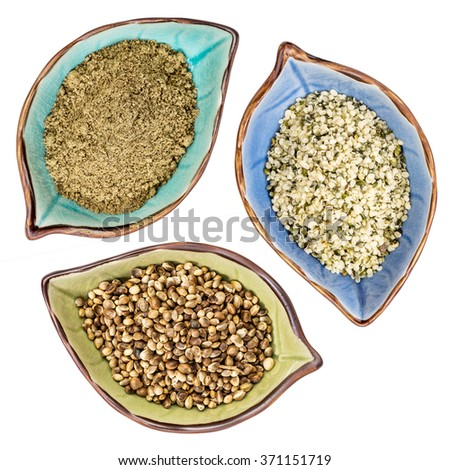 a set of hemp seeds, hearts and  protein powder, top view of isolated leaf shaped ceramic bowls - stock photo