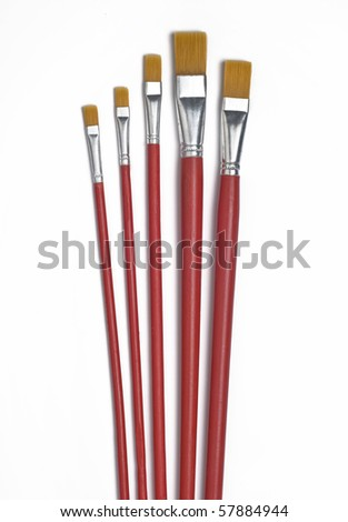A set of long paint brushes. - stock photo