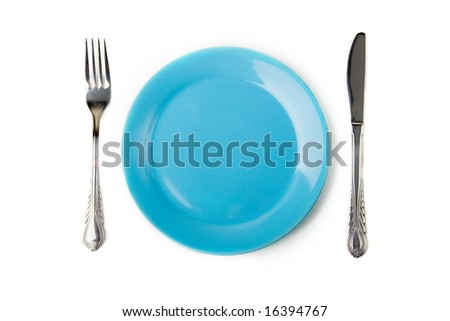 a set of metal fork and knife and blue plate - stock photo