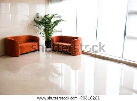 A set of office furniture near windows - stock photo