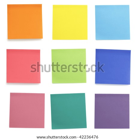 A set of office/work related rainbow colored paper sticky notes. Isolated on cork background. - stock photo