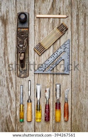 a set of old tools on a wooden table - stock photo
