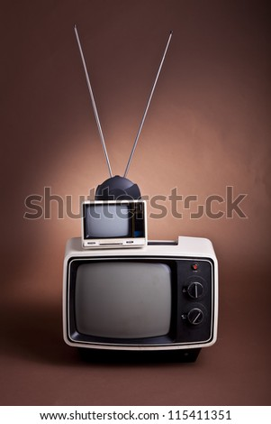 A set of retro style 70's TV sets with bunny ear antenna - stock photo