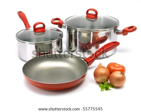 A set of saucepans and a frying pan isolated against a white background - stock photo