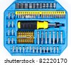 A set of screw tips and extensions with the screwdriver in the blue toolbox - stock photo
