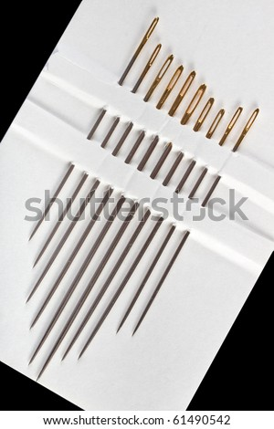 A set of sewing needles together in a white card - stock photo