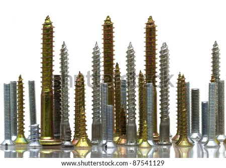 a set of silver and golden screws - stock photo