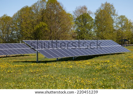 A set of solar panels on a meadow - stock photo