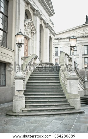 A set of stone steps at the entrance to a classic historic building in Germany
