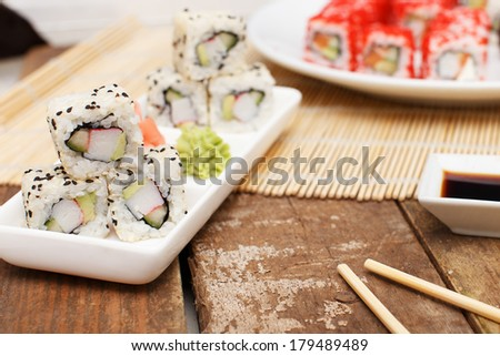 A set of sushi on a rectangular white plate - stock photo
