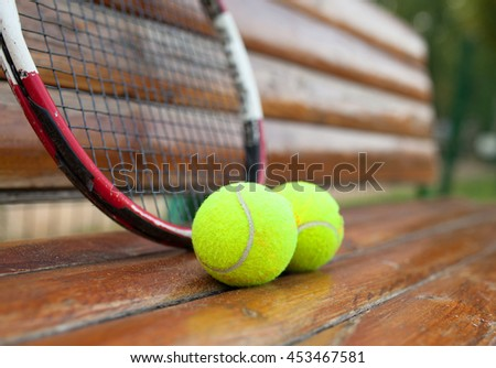 A set of tennis. Racket and balls.