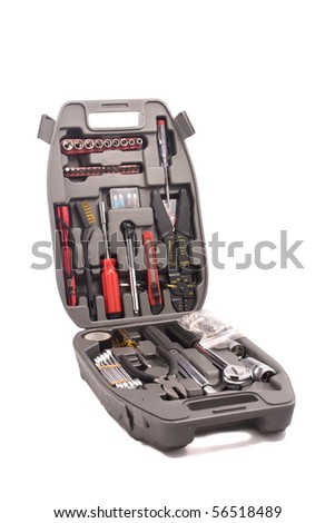 A set of tools in a special box isolated on a white background. Containing a screwdriver, pliers, removable screwdriver heads and other.