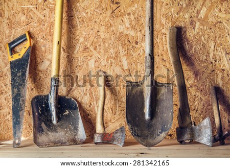 A set of tools on a wooden background. Top view. - stock photo
