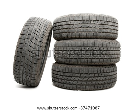 A set of tyres isolated on white background - stock photo