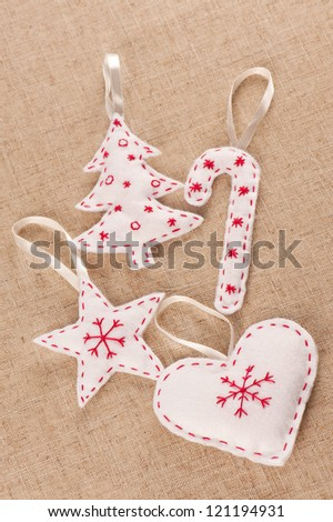 A set of white felt handmade Xmas decorations - stock photo