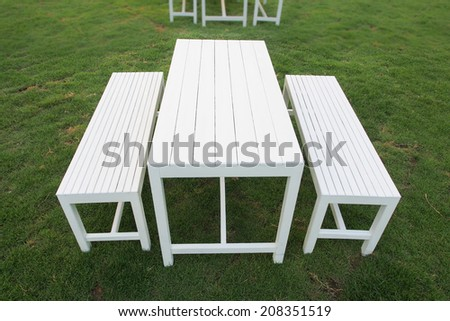 A set of white table and benches