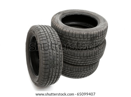 A set of winter tires isolated on white - stock photo