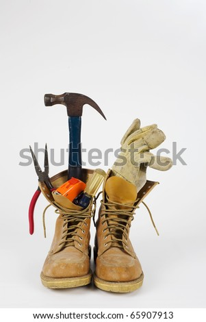 A set of work boots and tools for the do it yourself person. - stock photo