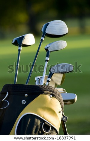 A set up new golf clubs on a beautiful golf course - stock photo