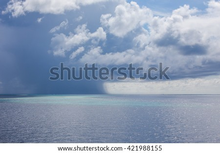 A severe thunderstorm over the ocean, Maldives - stock photo