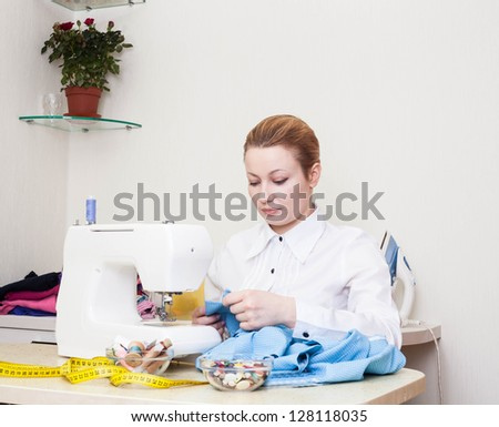 A sewer working on the sewing machine. - stock photo
