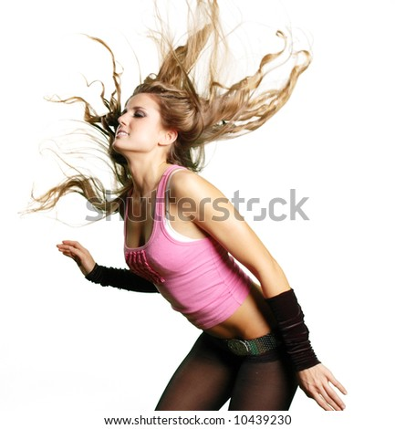 a sexy dancer girl is posing against white background - stock photo