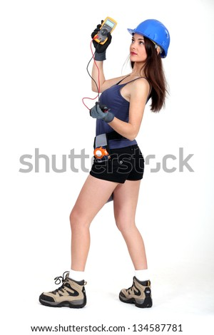 A sexy female electrician. - stock photo