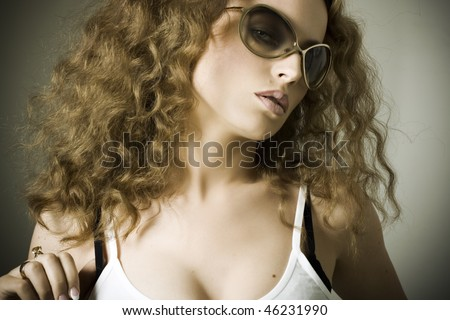 A sexy girl in sunglasses