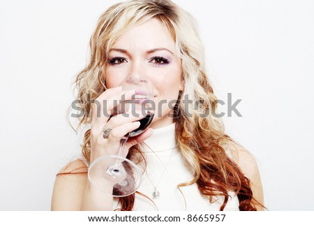 a sexy girl is having a drink and enjoying herself