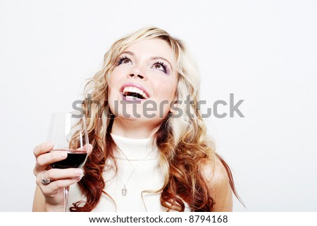 a sexy girl is having a drink and enjoying herself - stock photo