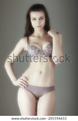 A sexy model poses in sensual lingerie.