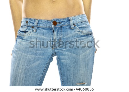 A sexy model wearing a pair of blue jeans against a white background
