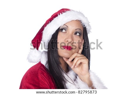 A sexy Santa Clause Asian woman in Christmas attire thinking about the winter holidays. - stock photo
