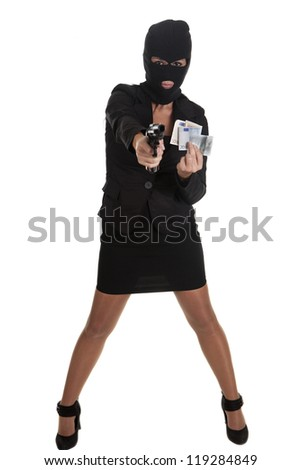 a sexy woman, committing a robbery - stock photo