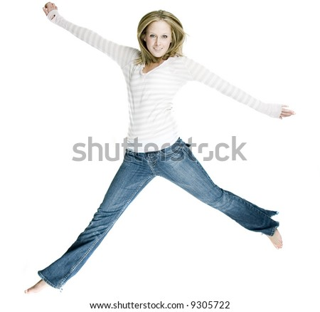 a sexy woman jumping with joy - stock photo