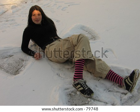 A sexy woman outside in the snow in New York City, having lots of fun - stock photo