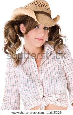 A sexy young barefooted cowgirl with pigtails - stock photo