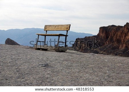A shabby bench in viewpoint near Zabriskie point in Death Valley. - stock photo