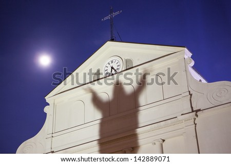 A shadow of Jesus is cast upon St Louis Cathedral in the French Quarter, New Orleans, Louisiana, USA. - stock photo