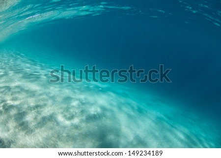 A shallow sand flat drops towards deep water in the Solomon Islands.  This area is found within the Coral Triangle and is high biological diversity. - stock photo