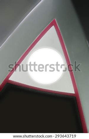 A-shape /  triangular structure gently indicating the direction onward and upward as a modest allusion to progress, growth or better perspective. Round frame is ready for slogan or logo placement. - stock photo