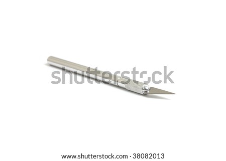 A sharp hobby knife isolated on white