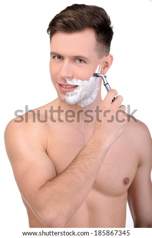 A shaving handsome man, isolated on white