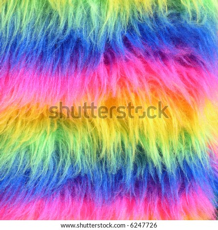 A Sheepskin dyed in a rainbow of colors - stock photo