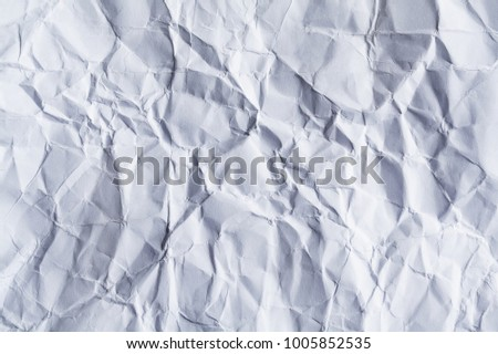 A sheet of white blank crumpled paper as background, texture