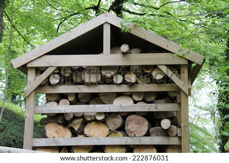 A Shelter to Store Wooden Fire Logs. - stock photo